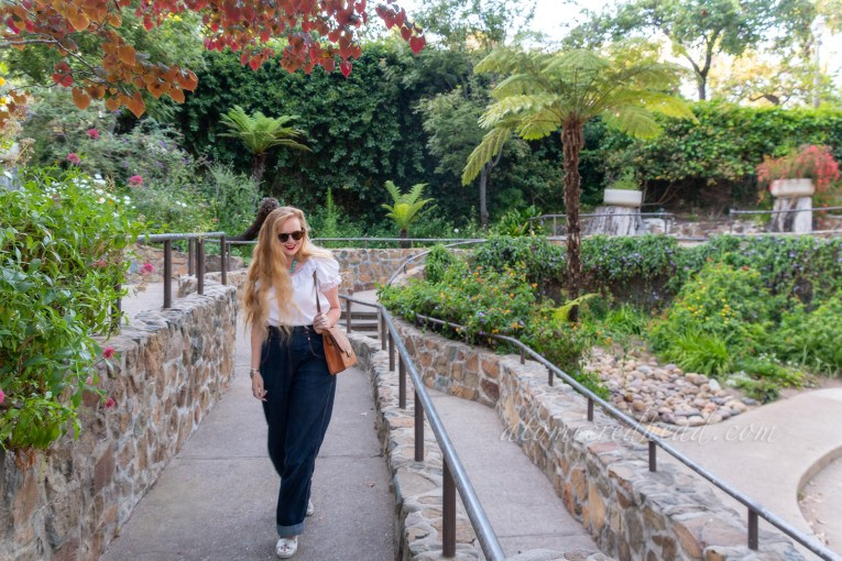 Myself walking through the pathways of the Zoro Garden, which features short rock walls, and lush plants around.