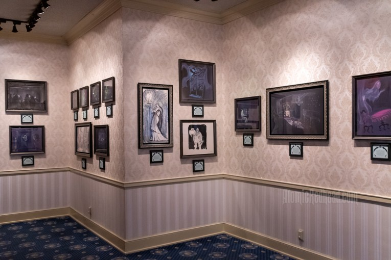 Overall image of gallery featuring walls of concept art.