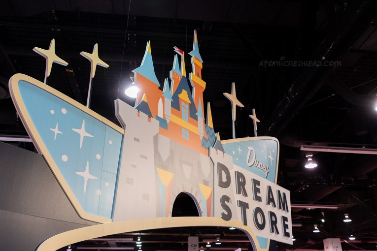"A massive cartoon castle is featured on a sign reading ""Dream Store"""