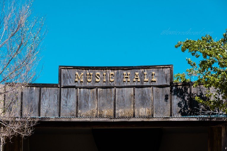 "A shell of a faux western building reading ""Music Hall"" at the top."