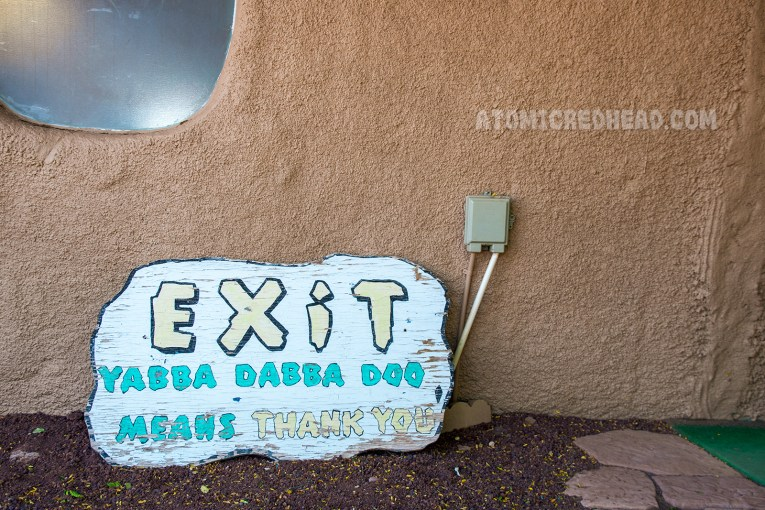 "Exit sign reads ""Exit Yabba Dabba Doo means Thank You"""