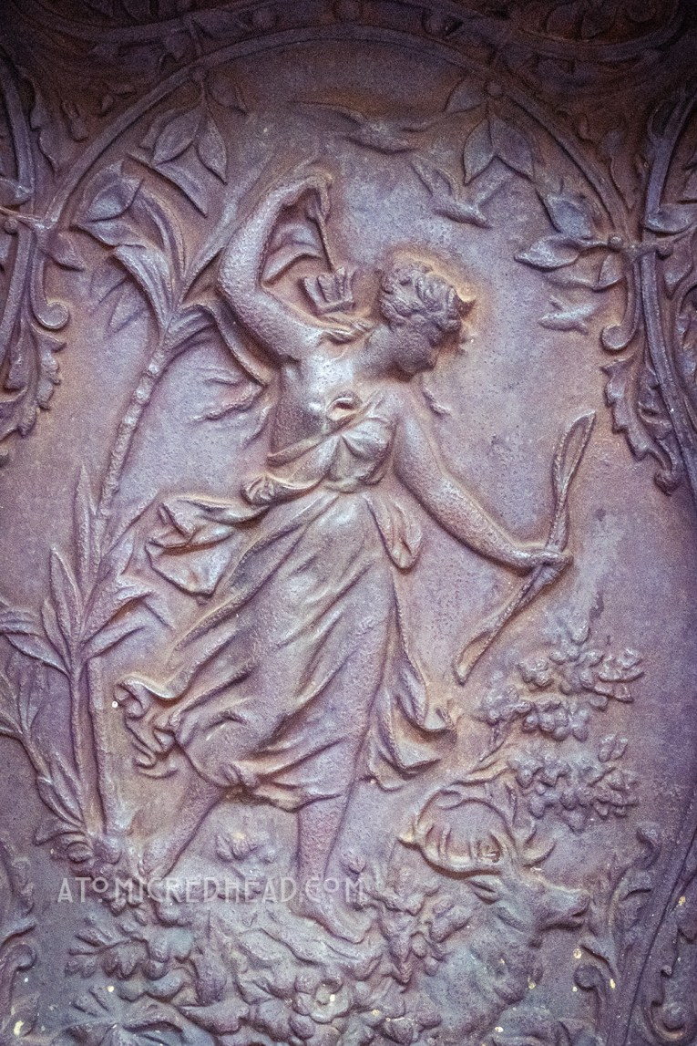 A metal panel of a female archer.