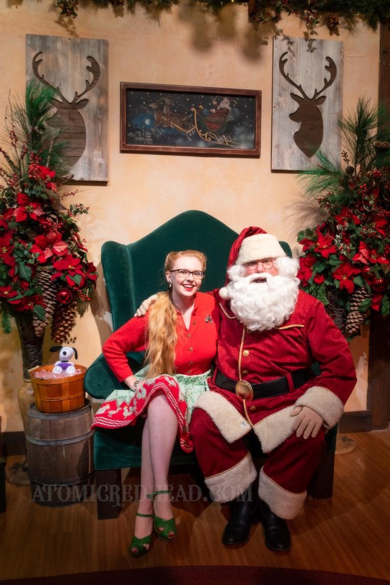Myself sitting with Santa.
