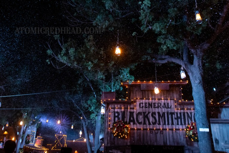 The Blacksmith Shop, trimmed in white lights, and lanterns hang from the trees.