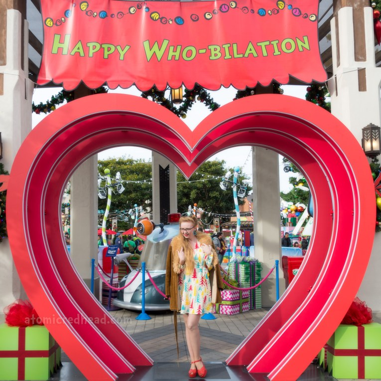 Myself, standing in a heart shaped archway into the Whoville area.