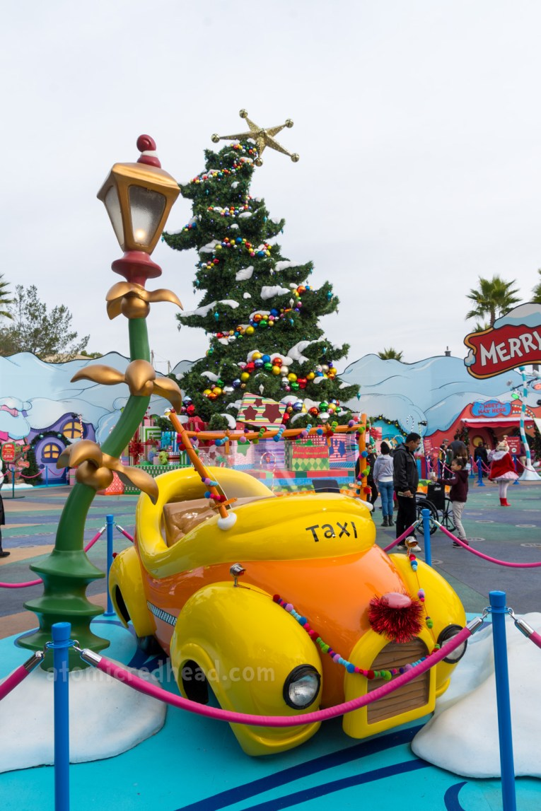 A whimsical yellow and orange taxi, which was featured in the film, How the Grinch Stole Christmas.