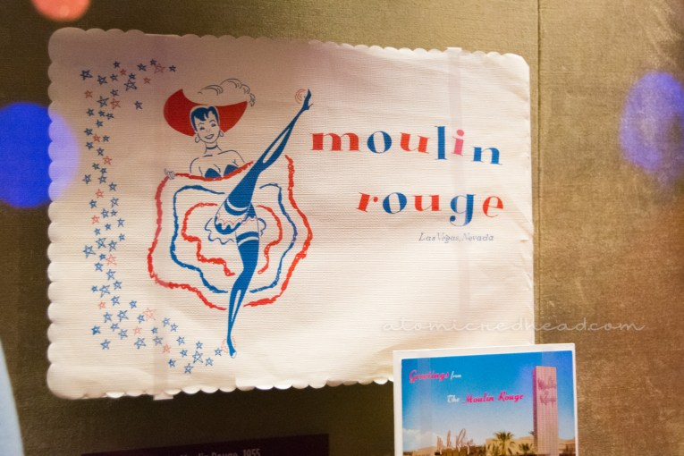 A Moulin Rouge placemat and postcard on display at Vegas' Mob Museum.