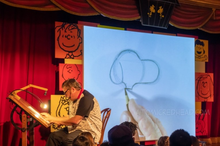 Noel, the art teacher at Peanuts Sketch School shows how to draw Snoopy.