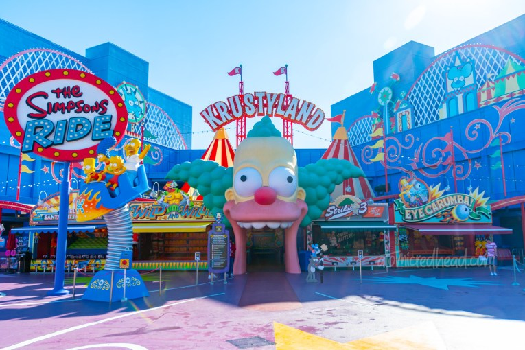 Entrance to The Simpsons Ride, which is the giant head of Krusty the Klown.