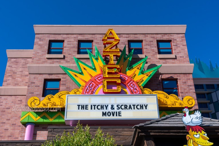 "Neon facade for the cinema in Springfield, the Aztec. The marquee reads ""The Itchy & Scratchy Movie"""