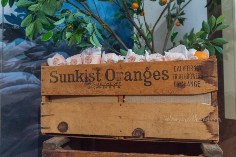 "A crate full of faux oranges. The side reads ""Sunkist Oranges"""