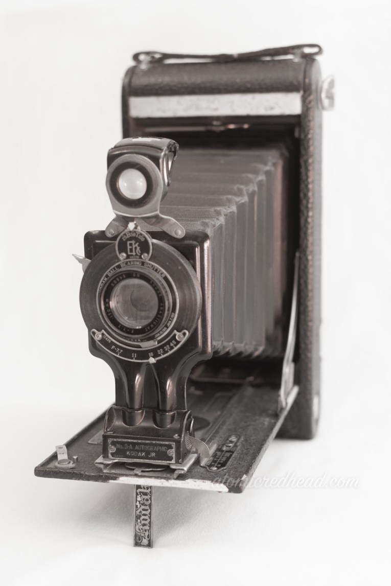 Kodak Autographic Number 3A. A large black camera with a bellows.