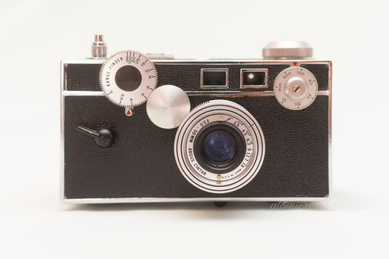 Argus C3. A black body with silver dials rangefinder style camera.