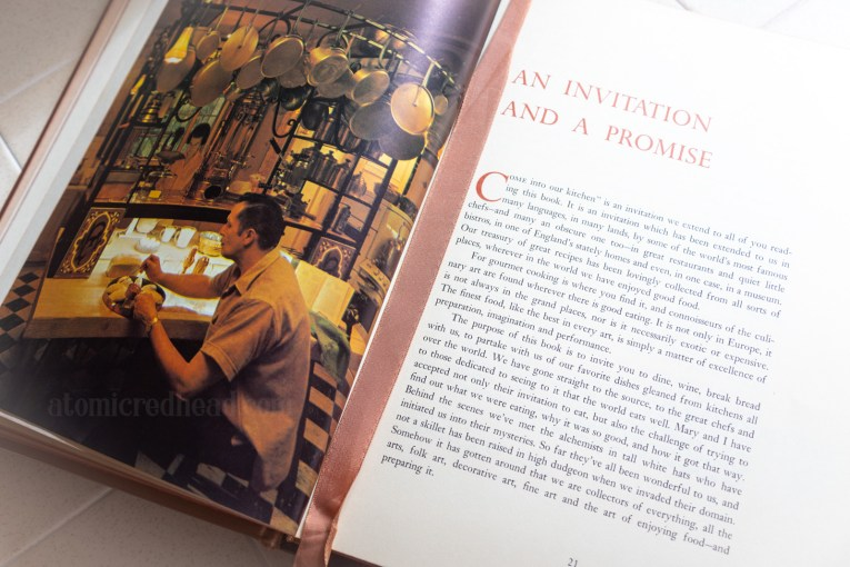 "The book open. On the left page a photograph of Vincent Price and his wife Mary in their kitchen. The right page reads ""An Invitation and a Promise"""