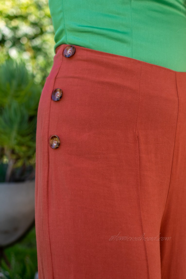 Close-up of the side button detail on the pants.