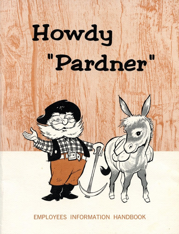 "The Employee Handbook, which features a woodgrain background, and the ""Old Timer"" with a white beard, black hat, check shirt, black vest, brown pants, and black boots, waving, and holding a pick ax. A donkey stands next to him. Black text at the top reads ""Howdy Pardner"""