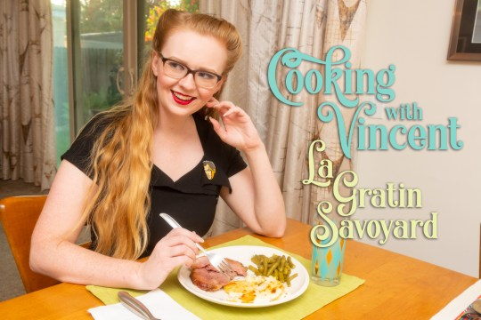 "Myself seated at our dining room table, holding a fork over a plate of ham, potatoes, and green beans. Text overlay reads ""Cooking with Vincent La Gratin Savoyard"""