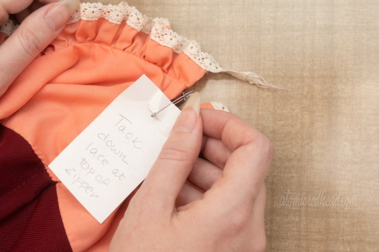 Attaching a note to a dress to remind me to tack down the lace on the collar.