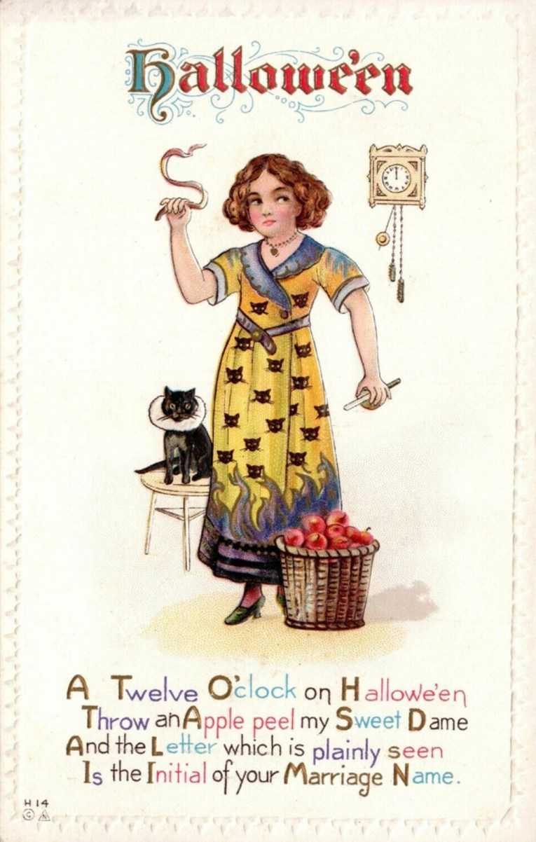 "Postcard of a woman wearing a yellow and blue dress with black cat heads on it. A clock hangs behind her with 12 on it. In her hands she holds an apple and knife with one, peelings in the other she is abut to toss over her shoulder. Text at the top reads ""Halloween"" and text at the bottom reads ""A Twelve O'clock on Halloween Thrown an Apple peel my Sweet Dame And the Letter which is plainly seen Is the Initial of your Marriage Name."""