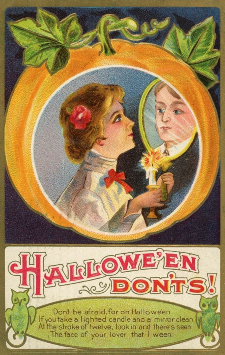 "Inside a pumpkin a woman holds a mirror and candle. Text below reads ""Halloween Don'ts! Don't be afraid, for on Halloween If you take a lighted candle and a mirror clean At the stroke of twelve, look in and there's seen the face of your lover that I ween."""
