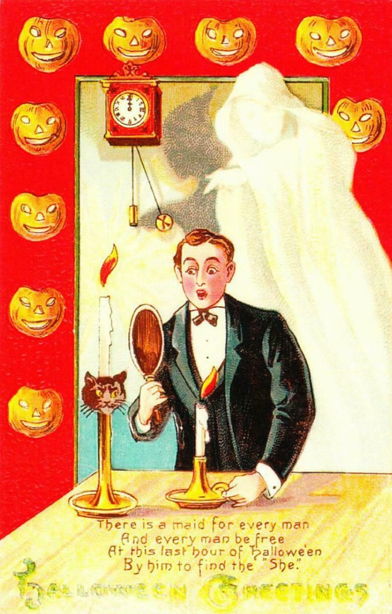 "A gentleman in a tux holds a candle and mirror, a ghostly figure stands behind him. Text below reads ""There is a maid for every man And every man be free At thsi last hour of Halloween By him to find the 'She' Halloween Greetings."""