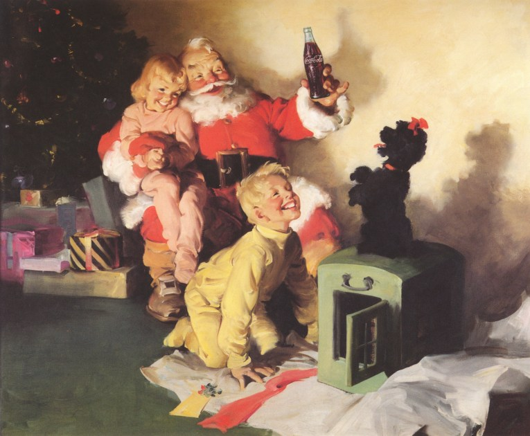 Santa sits with a little girl on his lap, and a Coke in his hand. In front of him a little boy looks at a black poodle who sits on his hind legs.
