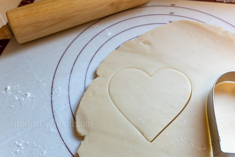 The indentation of where the heart shaped cookie cutter was in the dough.