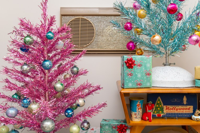 Our pink aluminum tree with various ornaments of green and blue with stars on them.
