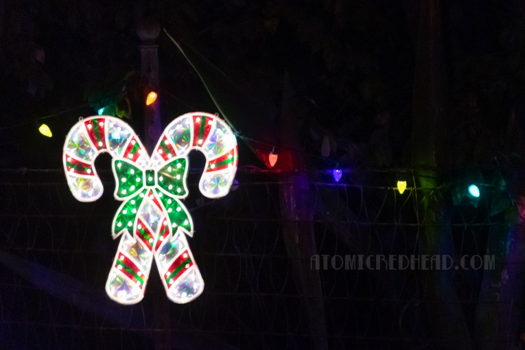 A lighted pair of crossed candy canes.