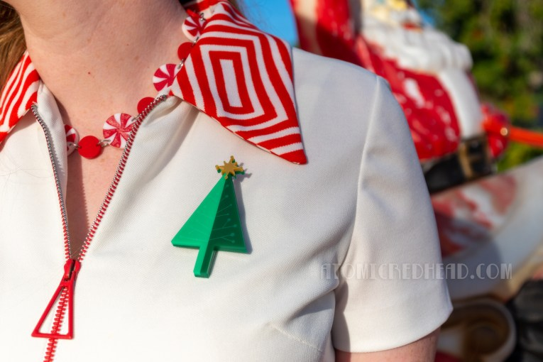 Close-up of my necklace, which is peppermint candies, and my Christmas tree brooch.