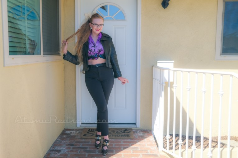 Myself standing in front of our front door, wearing a black leather motorcycle jacket, purple and teal Hawaiian shirt, and black jeans.