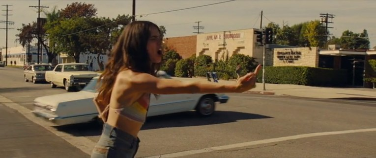 The intersection as it appeared in Once Upon a Time in Hollywood, Pussycat flips off a cop car that has driven by.