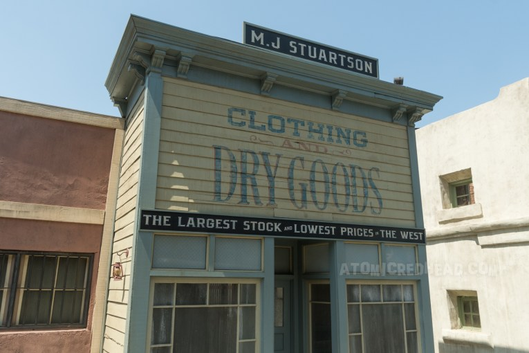 """The same building on the lot, with """"Dry Goods"""" still painted on it."""