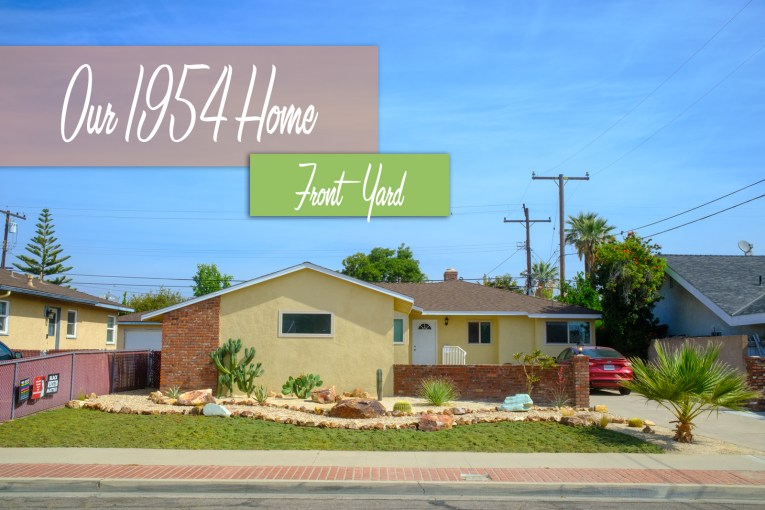 """Our completed yard, a patch of green goes from the sidewalk to a rock edge pathway, past it features warm, decomposed granite and a variety of cacti. Text overlay reads """"Our 1954 Home Front Yard"""""""