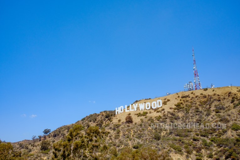 The Hollywood sign from below, with nothing but bushes surrounding the area.