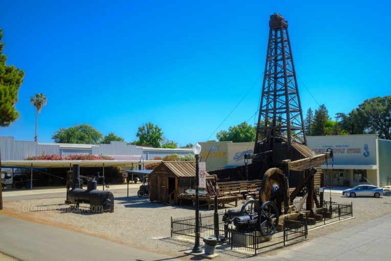 A tall oil rig rises from the outdoor portion of the museum.