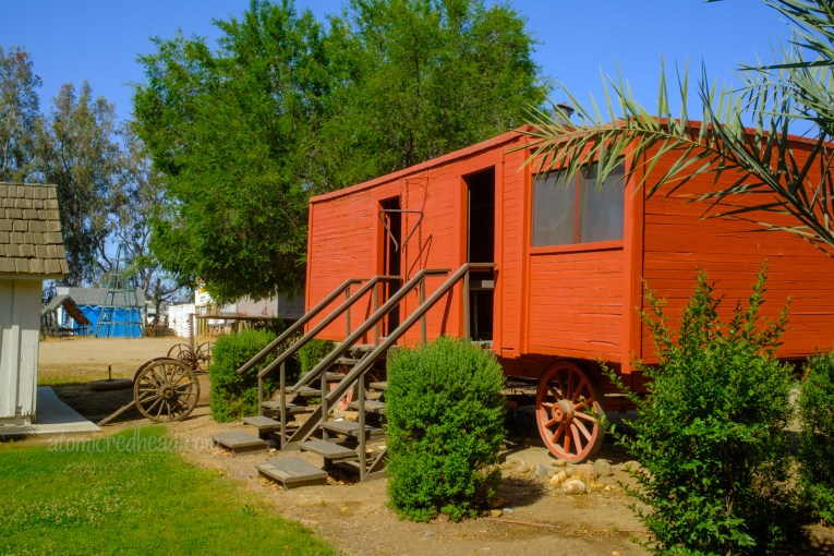 An old cook wagon, painted red, it features a massive dinner bell just outside the doors.