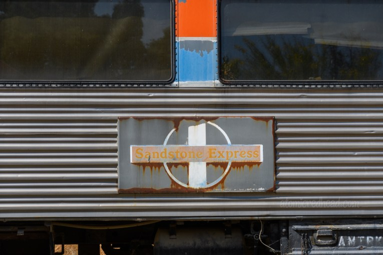 """Close-up of a railroad car, with text reading """"Sandstone Express"""""""