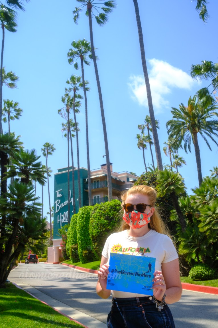 """Myself standing in front of the Beverly Hills Hotel holding a sign that reads """"#PaulRevereWasHere"""""""