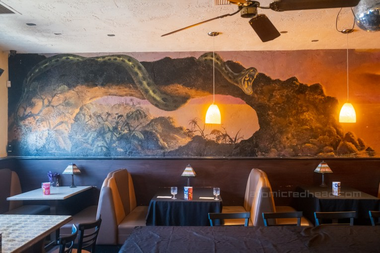 Mural of a giant snake in the bar of the Aztec.