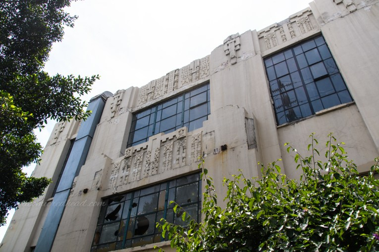 Art deco, almost a temple like style, details above windows.