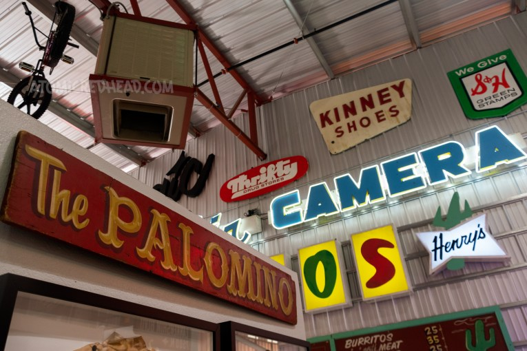 """Hand painted sign reading """"The Palomino"""" yellow letters over red."""