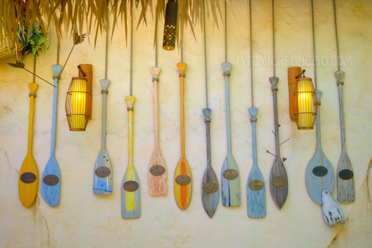 A variety of colorful paddles hang on the wall of the Tropical Hideaway restaurant.