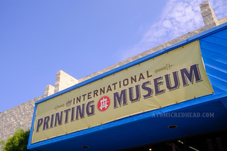 """Exterior of the museum, with a large sign reading """"International Printing Museum."""""""