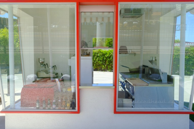 The pick-up window, which allows the customer to see inside the small restaurant.