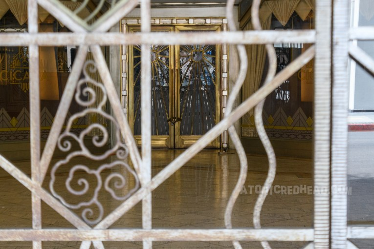 Entry to Cicada today, as seen through the same fence, with the etched, frosted glass and gold doors in the back.