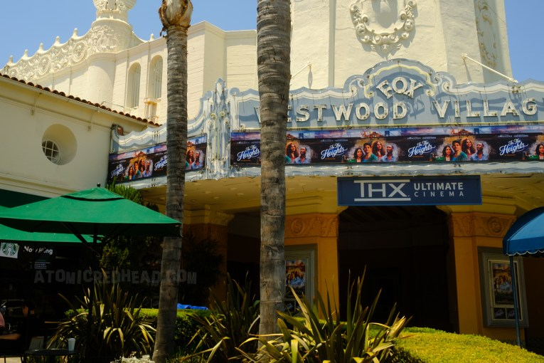 The Fox Westwood Village marquee today, with neon. However, instead of a traditional marquee as seen in the film, it features a banner advertising the showing of In the Heights.