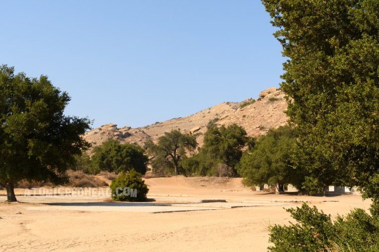 The same view today, with no buildings, just foundations from the Corriganville buildings, and scattered trees and bushes.