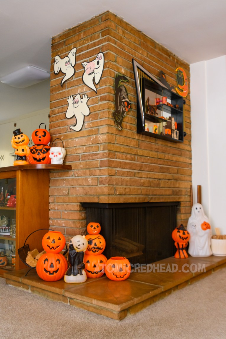 Overall view of our fireplace, with die cut ghosts handing, a shadow box hangs on one side, with various die cut black cats around.