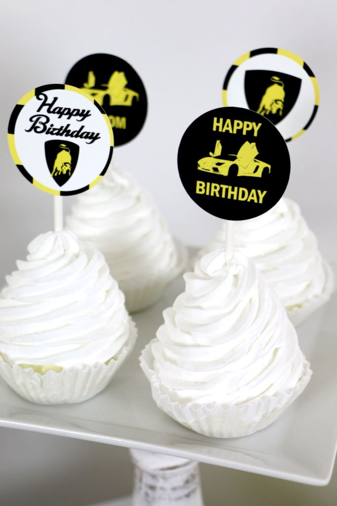 Yellow lamborghini birthday decorations and cupcake toppers
